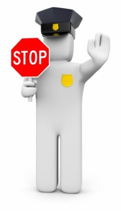 A man with a stop sign